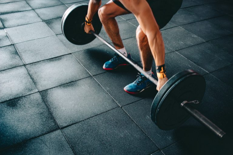 man picking up a barbell