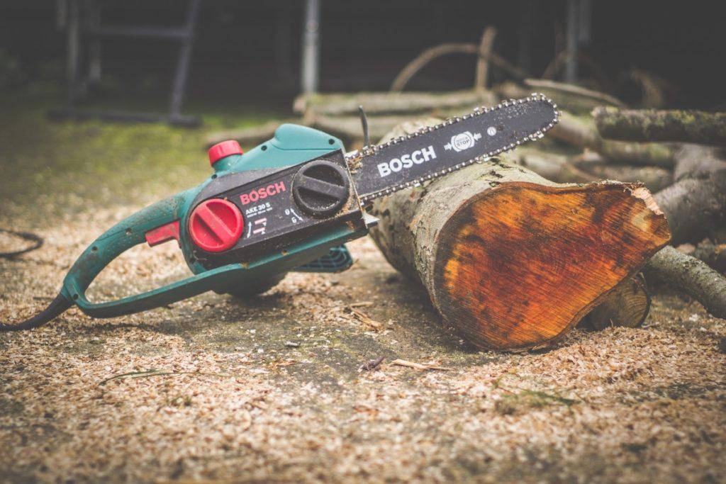 chainsaw against a log